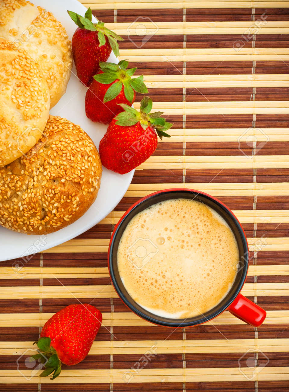 coffee, buns and strawberries on table, top view Stock Photo - 6662279