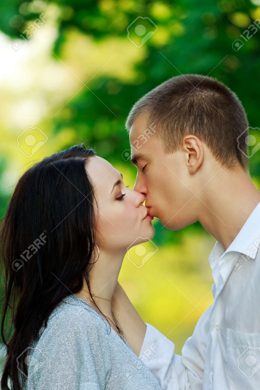 kissing couple in the park, closeup Stock Photo - 7622014