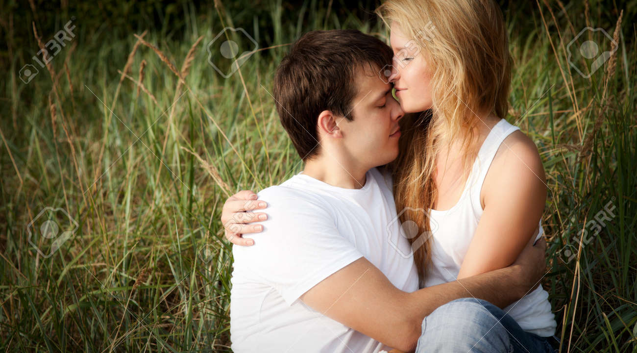 young couple embrace in high grass Stock Photo - 7662168