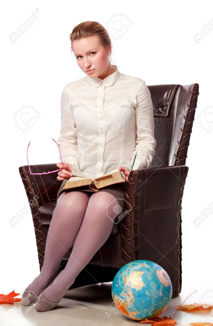 pretty female teacher sitting in armchair, isolated on white Stock Photo - 8630754