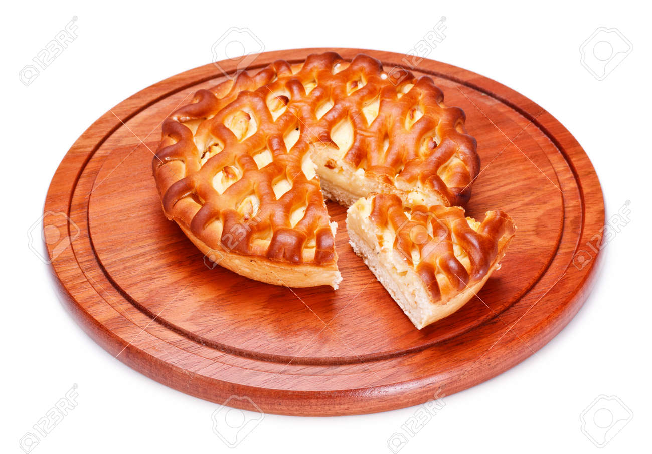 pie with curds on wooden tray, isolated on white Stock Photo - 8935160