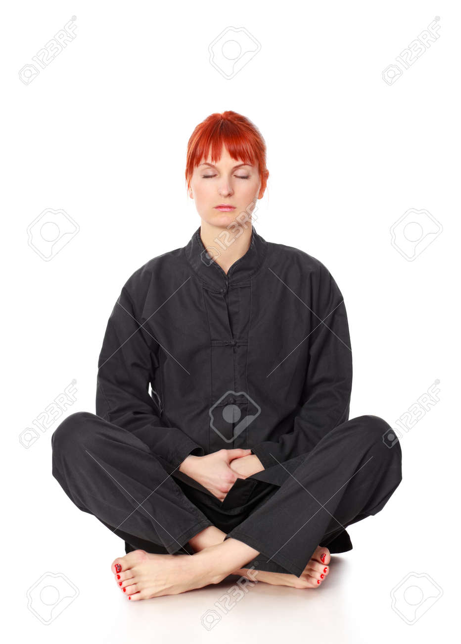 girl in black kimono siting and meditation isolated on white Stock Photo - 9183726