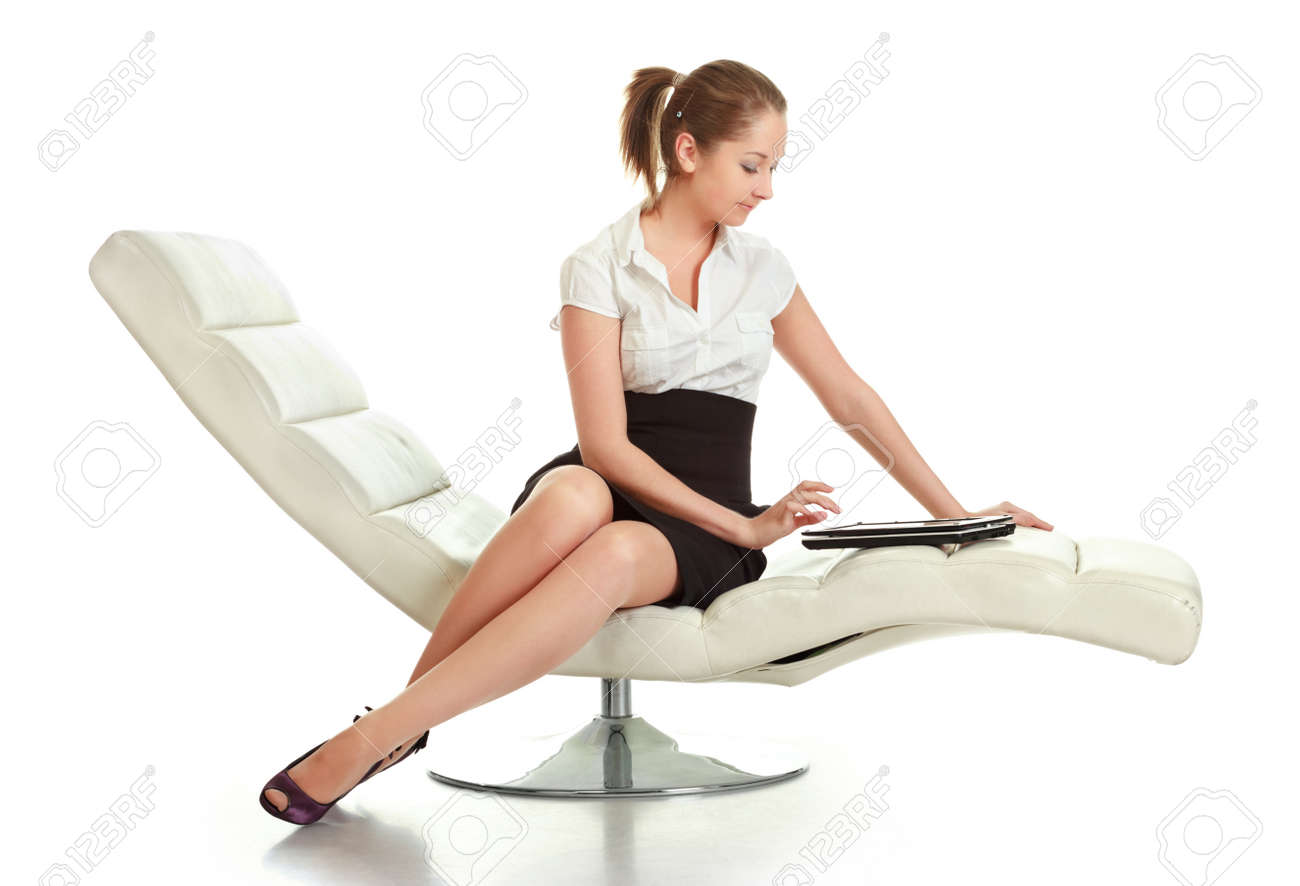 young businesswoman sitting with laptop, isolated on white Stock Photo - 9183828