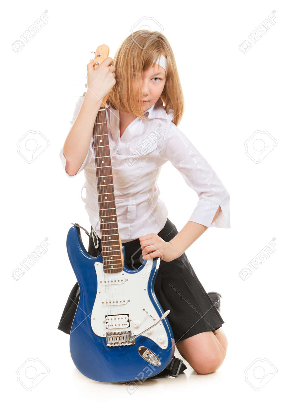 teen girl playing on a guitar, isolated on white Stock Photo - 9782802