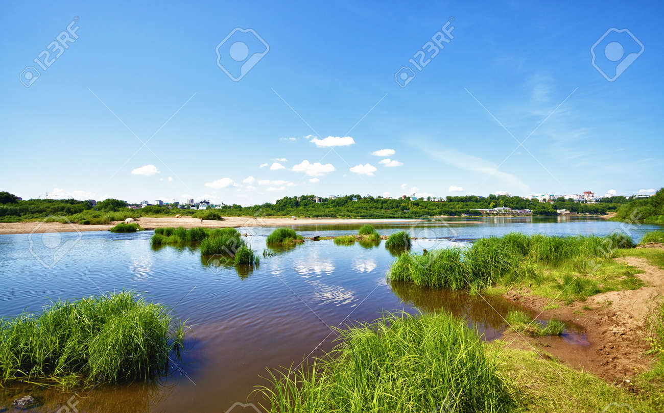 calm river under blue sky at summer day Stock Photo - 10931194
