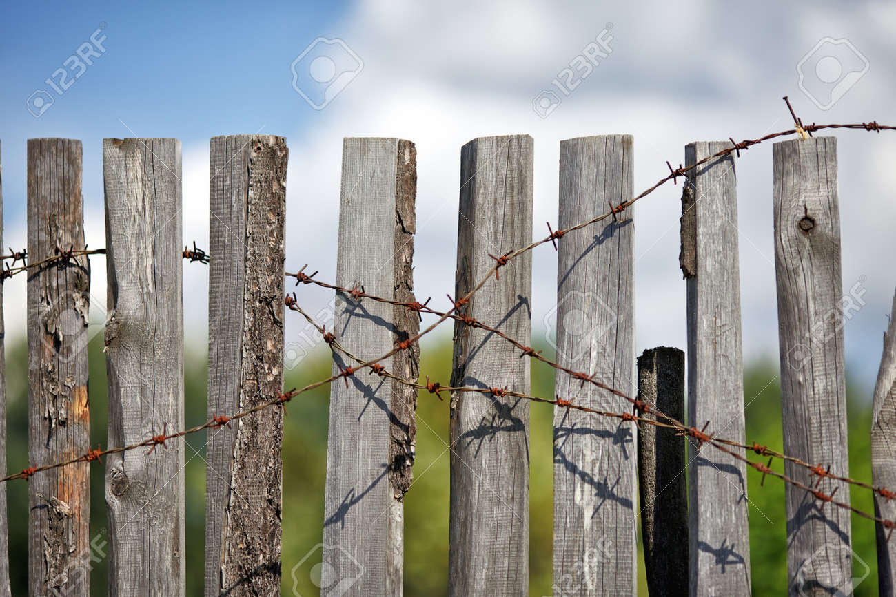 old wooden fence with rusted barbed wire Stock Photo - 11158595