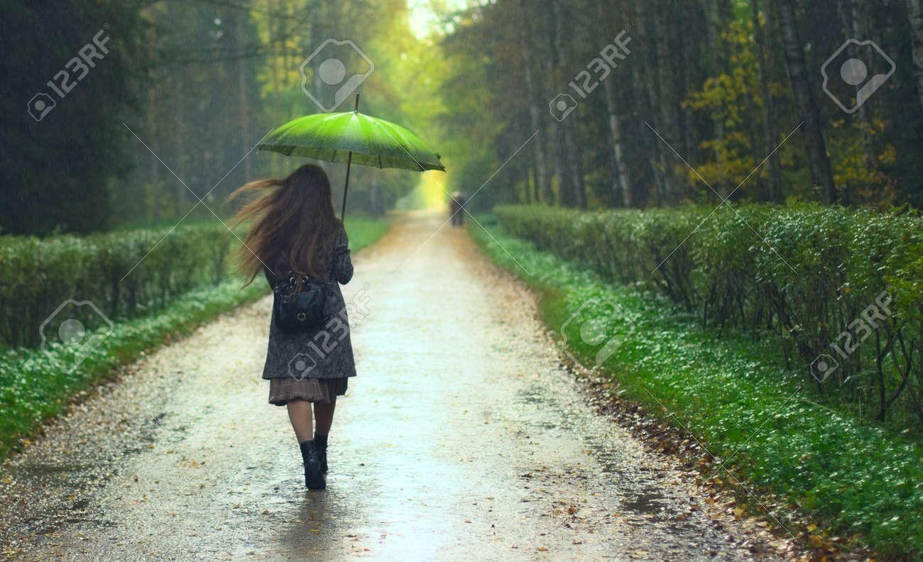 beautiful girl walking under rainfall in autumn park Stock Photo - 11646847