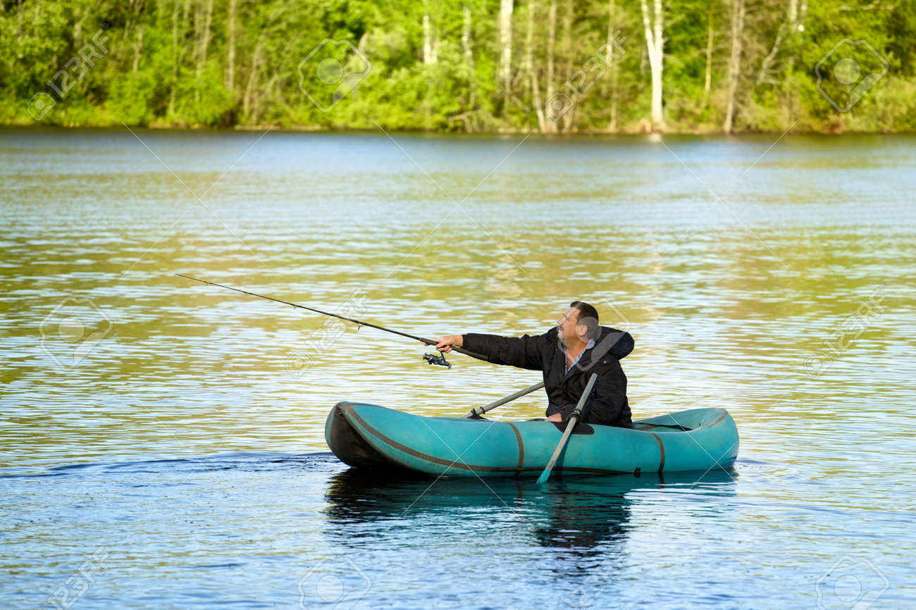 man fishing in rubber boat on a lake Stock Photo - 12477183
