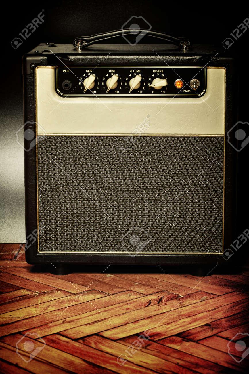 black vintage guitar aplifier on a floor Stock Photo - 14837644