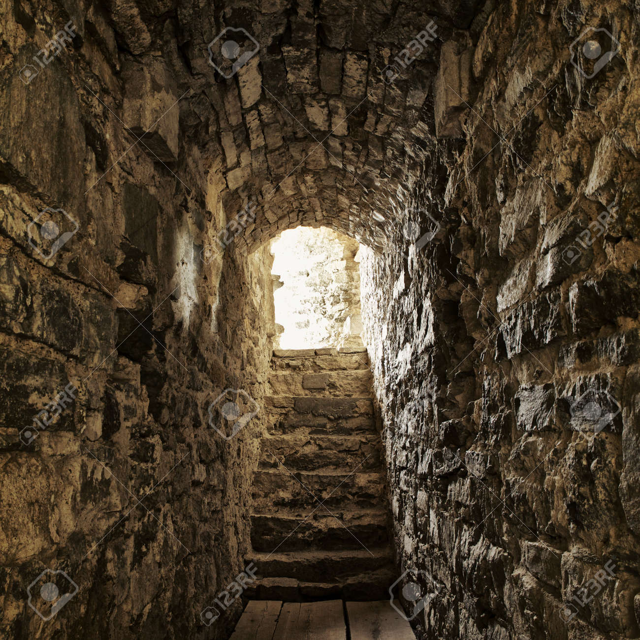 long stone corridor with stairway in ancient castle Stock Photo - 17586083