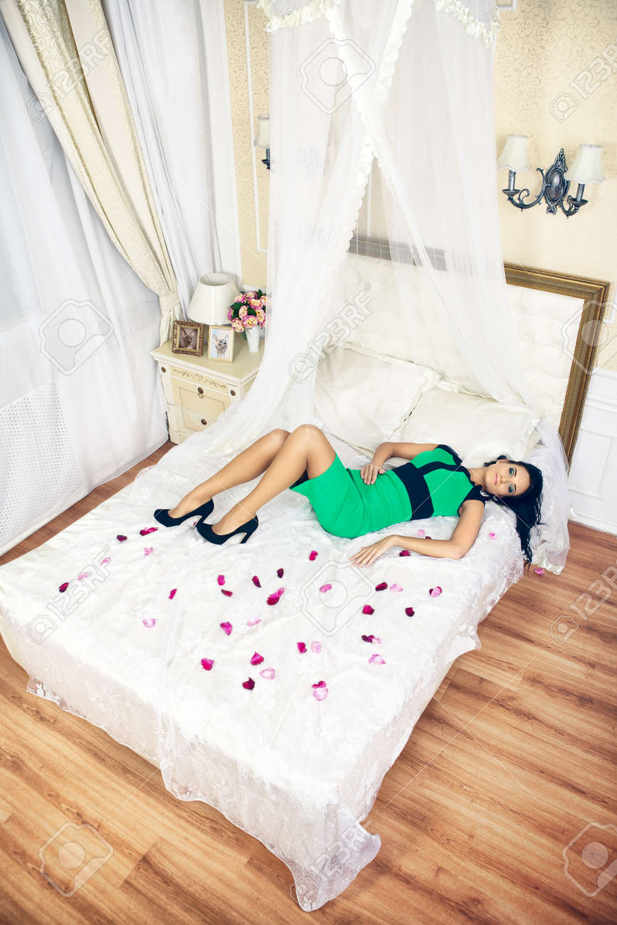 Young Beautiful Woman Lying On Bed With Rose Petals Stock Photo Picture And Royalty Free Image Image 38632114