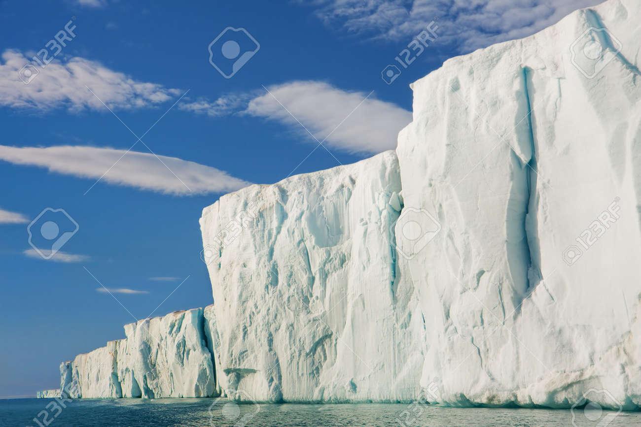 Sun shining on glacial cliff side.  Horizontally framed shot. Stock Photo - 6220465