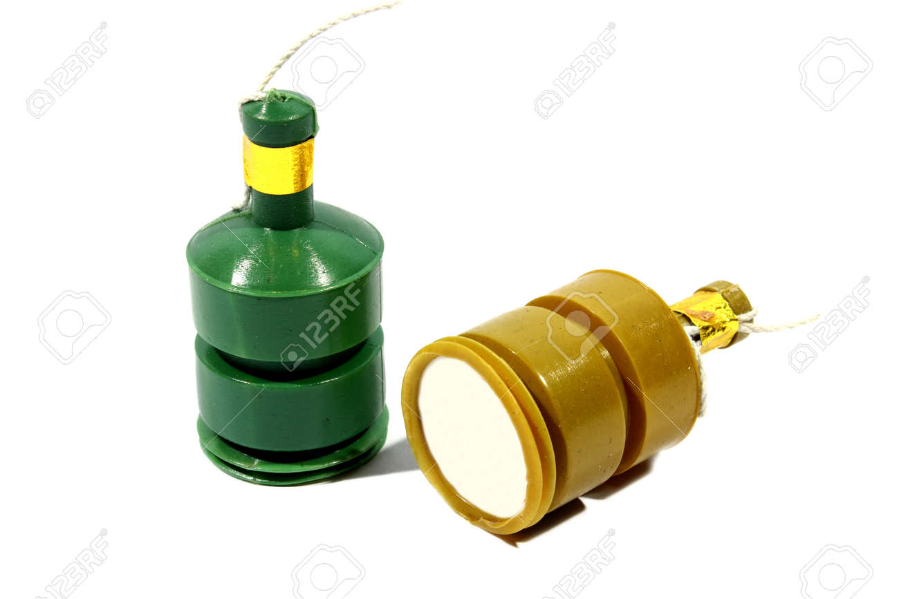 isolated green and yellow party poppers used at parties like new years eve stock photo
