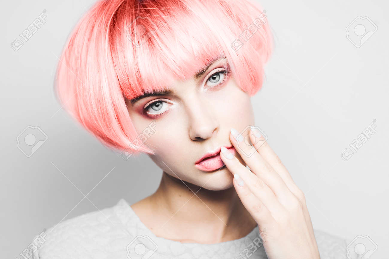 Beautiful girl with hair toned in living coral color. - 115911767