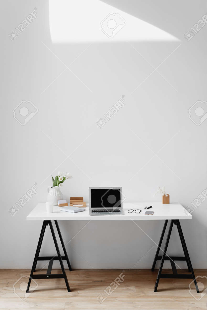 Office desk top table with laptop and office supplies. - 167155171