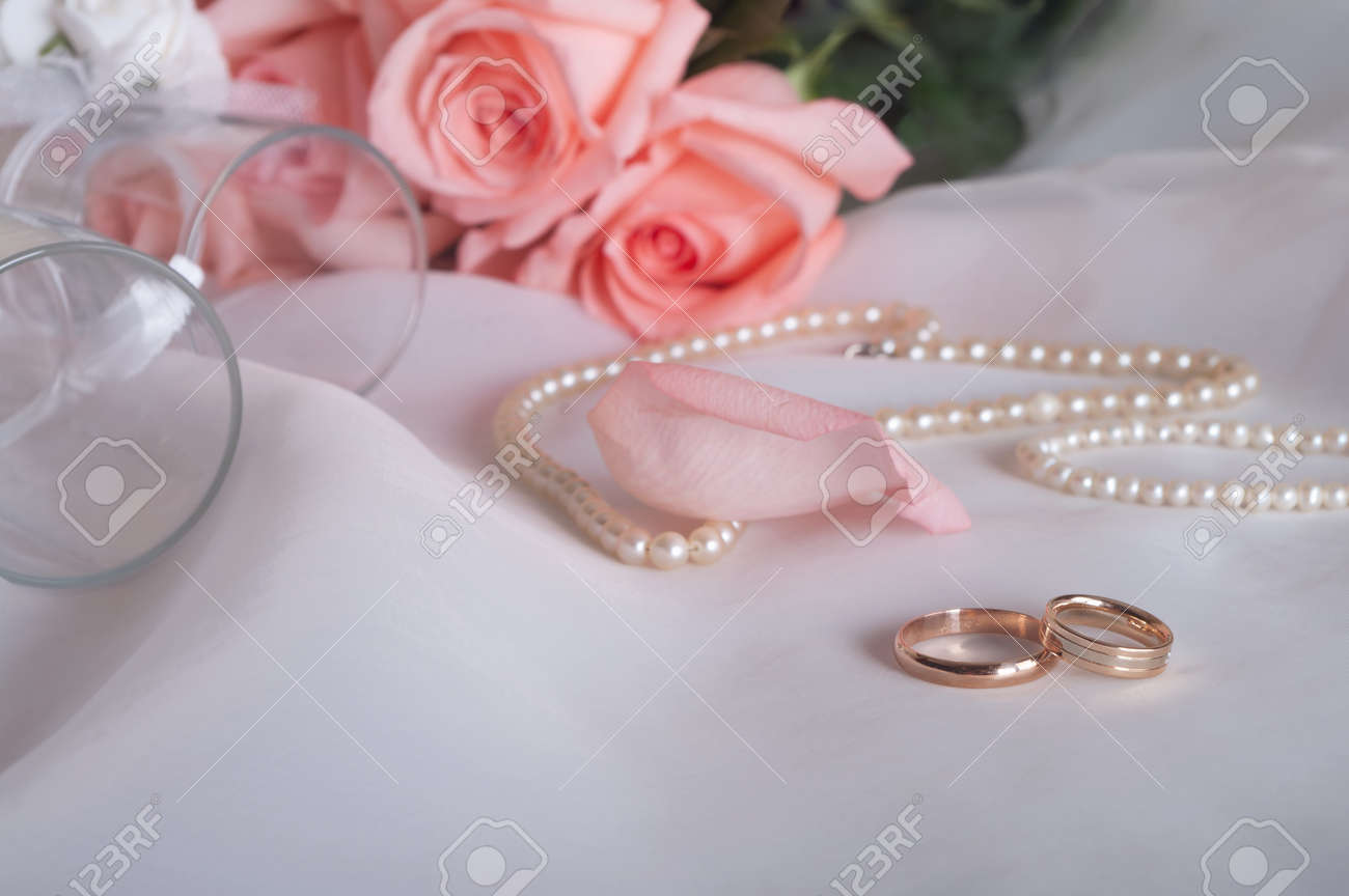 Rose, Pearl Necklace And Wedding Rings Stock Photo, Picture And ...