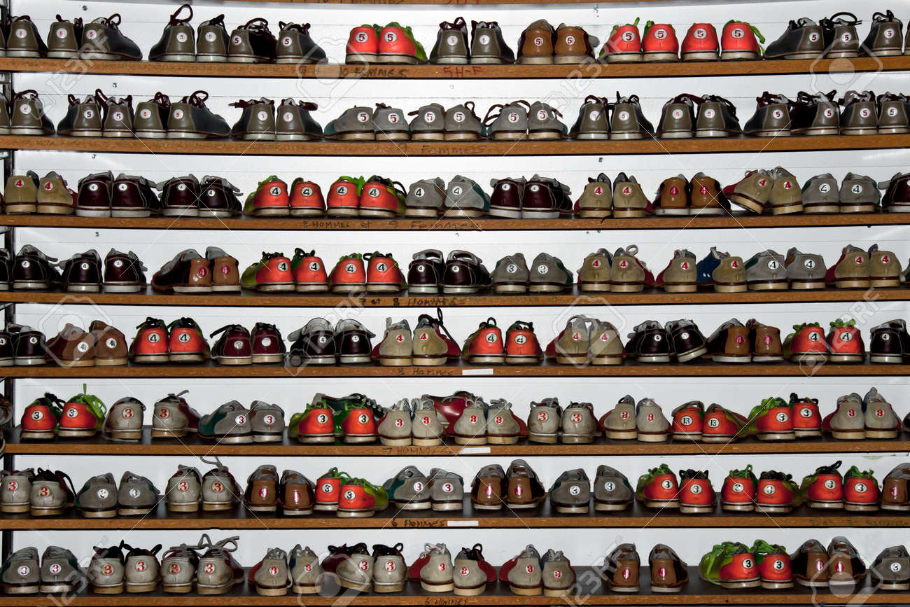 A Rack Full Of Different Colors And Size Bowling Shoes Stock Photo ...
