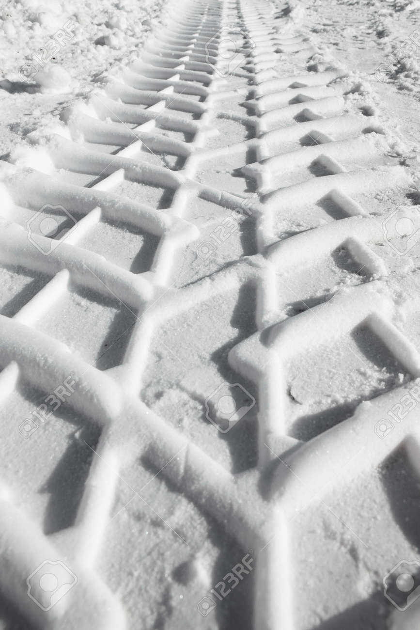 Tire tracks pattern prints in the snow Stock Photo - 20554452