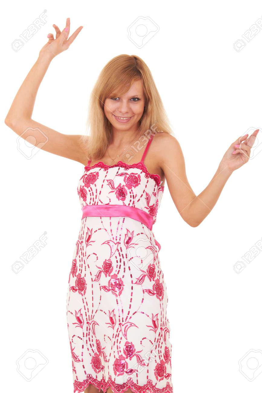 Niña Rubia Está Bailando En Un Vestido Rosa. Joven Agitando Sus ...