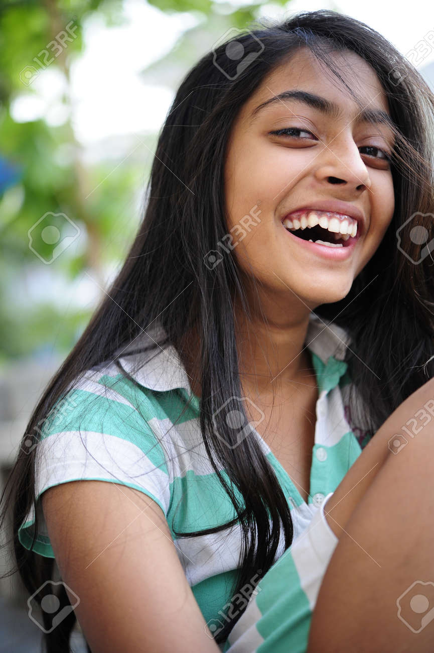 Smiling Indian Girl Enjoying Outdoors
