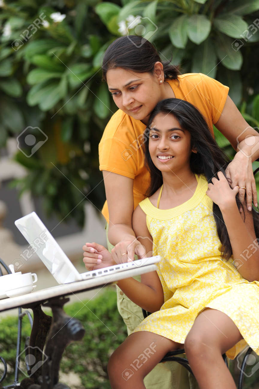 Mother and daughter working on laptop in outdoors Stock Photo - 7298702