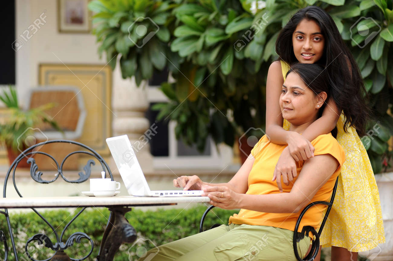 Mother and daughter working on laptop in outdoors Stock Photo - 7298750