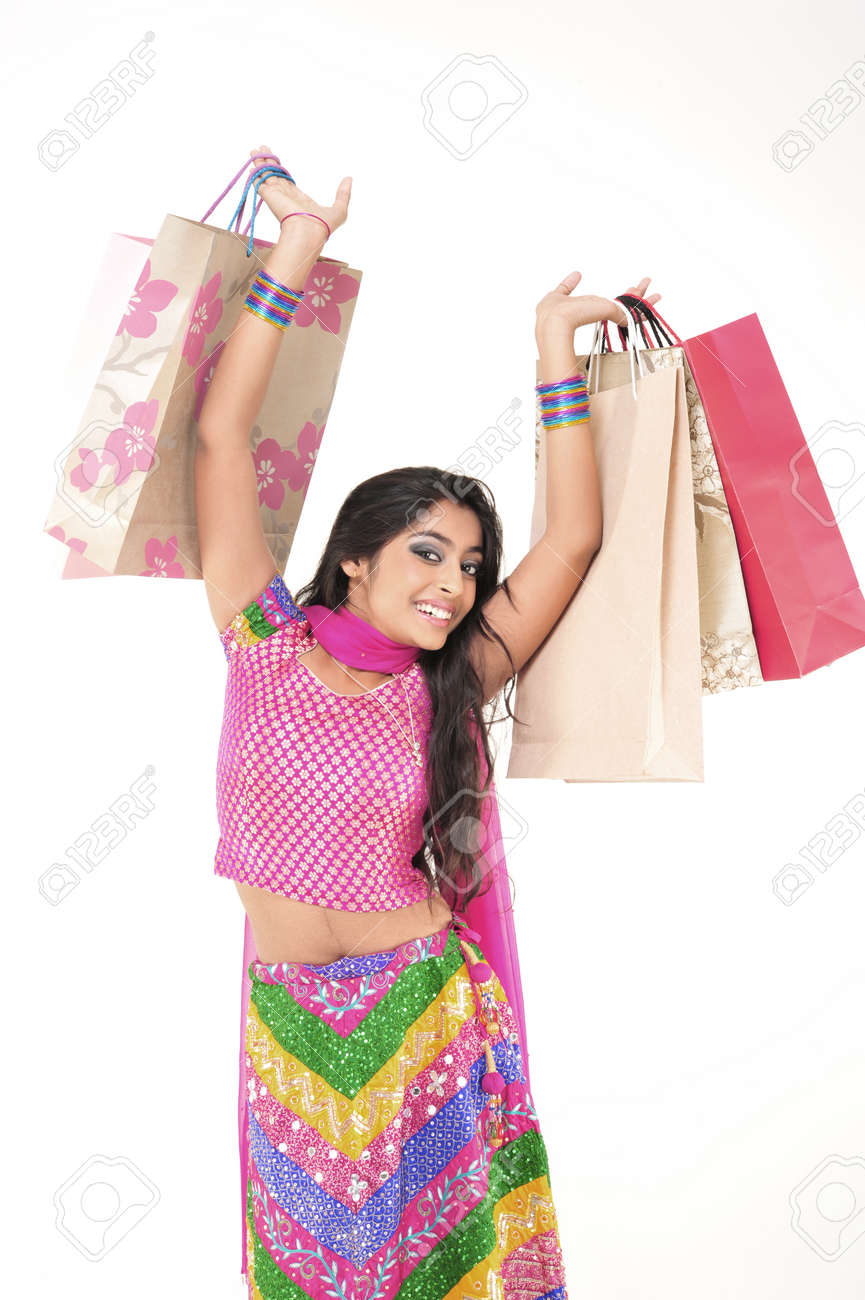 Indian Young girl wearing ethnic showing Shopping Bags Stock Photo - 15719918