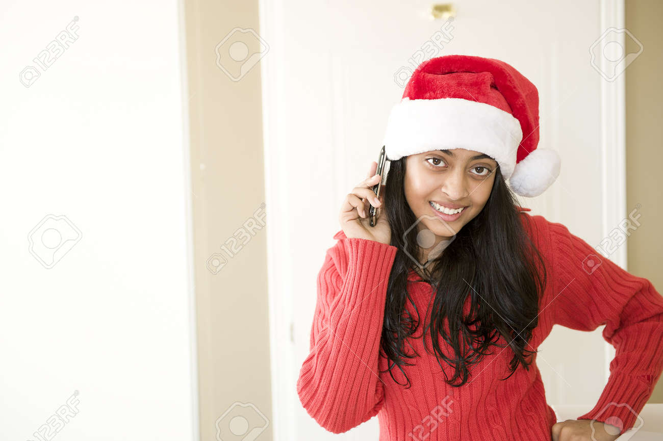 Pretty Indian Girl Wearing Christmas Cap Using Mobile Phone Stock ...