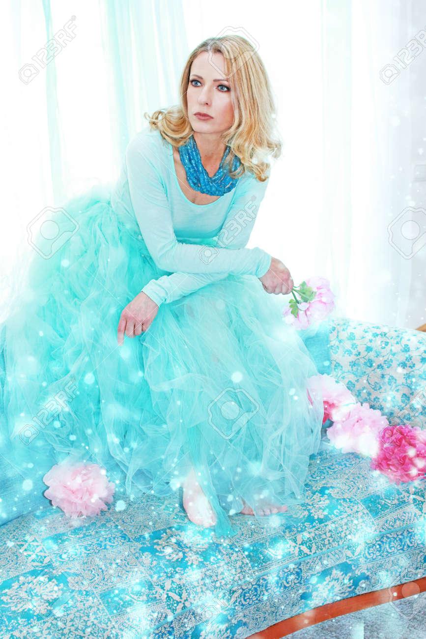 Attractive mature woman with petticoat skirt indoor Stock Photo - 87129316