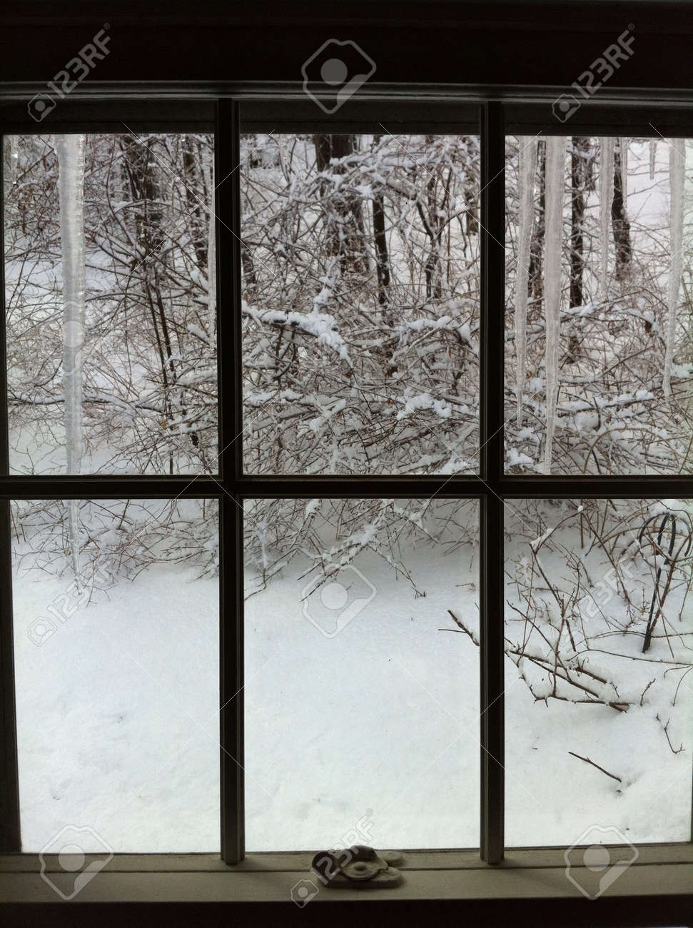 window looking outside to the snow stock photo picture and royalty