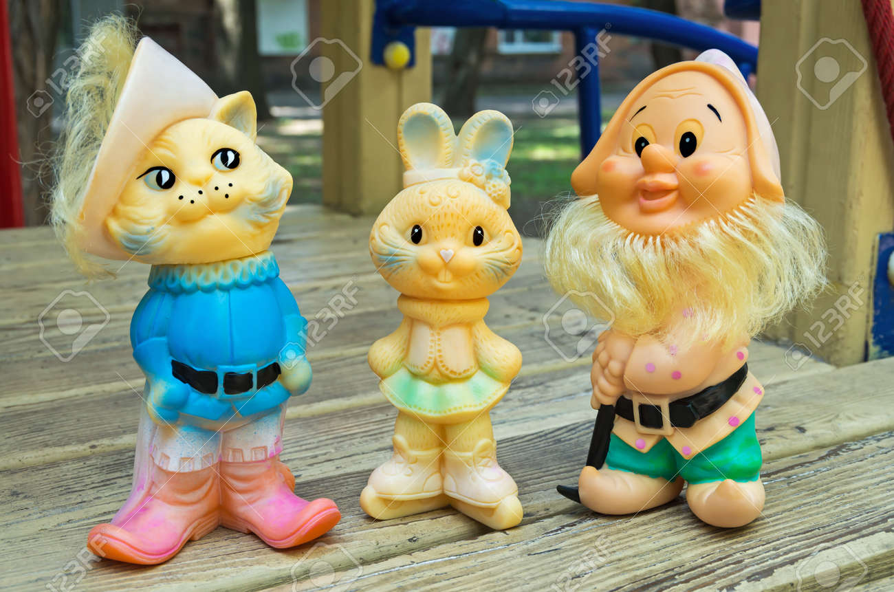 Old Rubber Toys In Form Of A Colored Rabbit, Cat And Gnome For ...