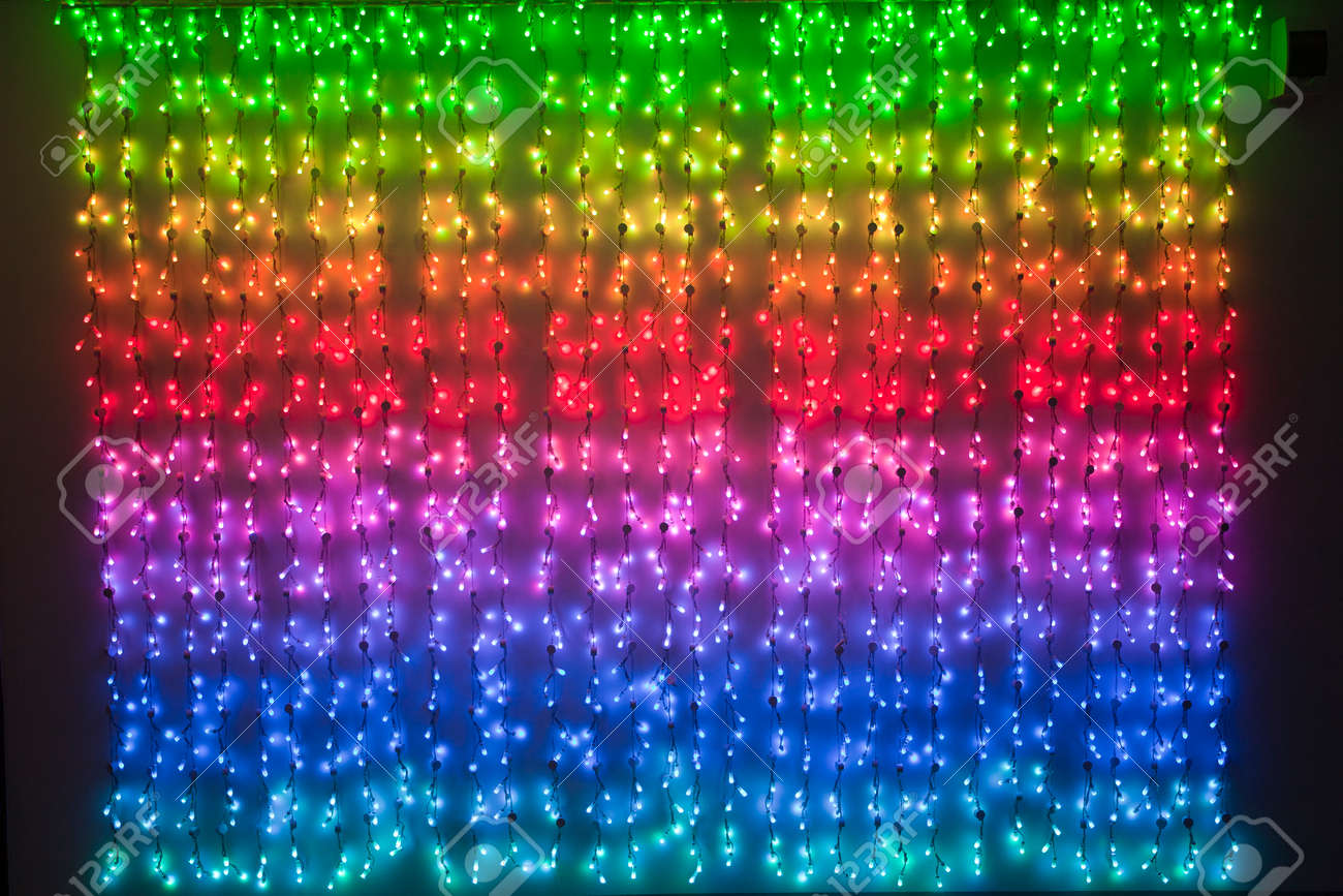 Rainbow Of Christmas Lights As A Background Stock Photo, Picture ...