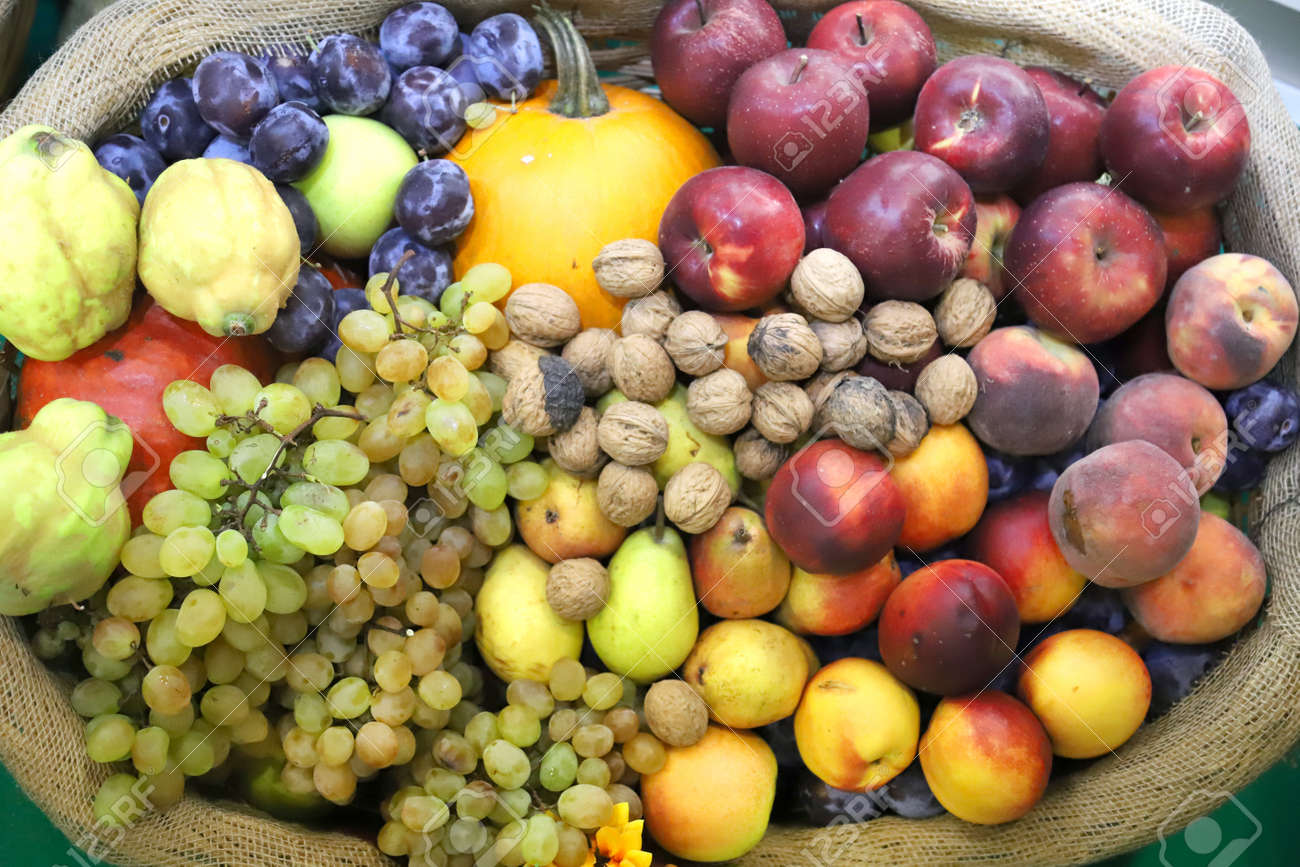 in basket as a background. Autumn fruit foods products as a background. Healthy organic harvest fruits as seasonal kitchen ingredients - 131441922