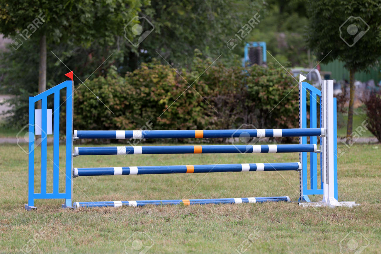 Image Of Show Jumping Poles On Empty Training Field Wooden Barriers Stock Photo Picture And Royalty Free Image Image 136336987