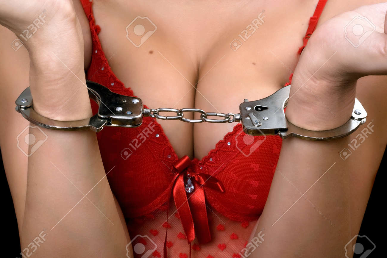 Sexy young woman in red lingerie handcuffed Stock Photo - 11370197