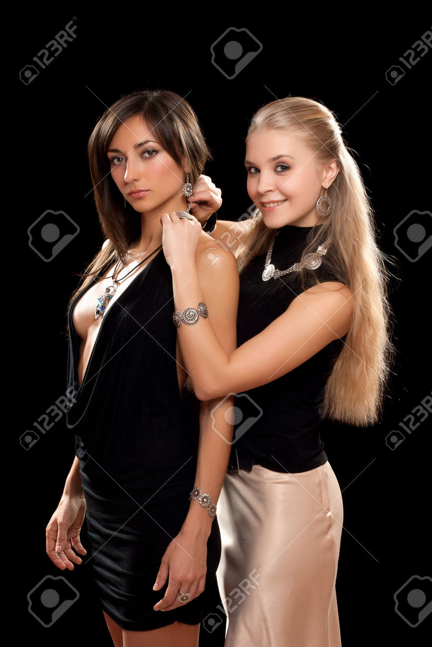 Two sexy young women. Isolated on black Stock Photo - 11370333