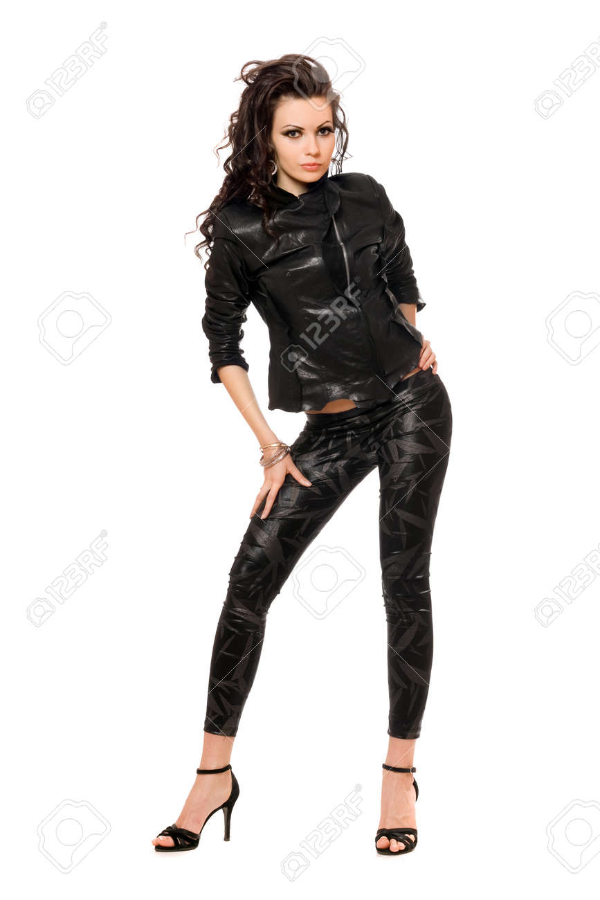 Pretty young brunette in black clothes. Isolated on white Stock Photo - 11819197
