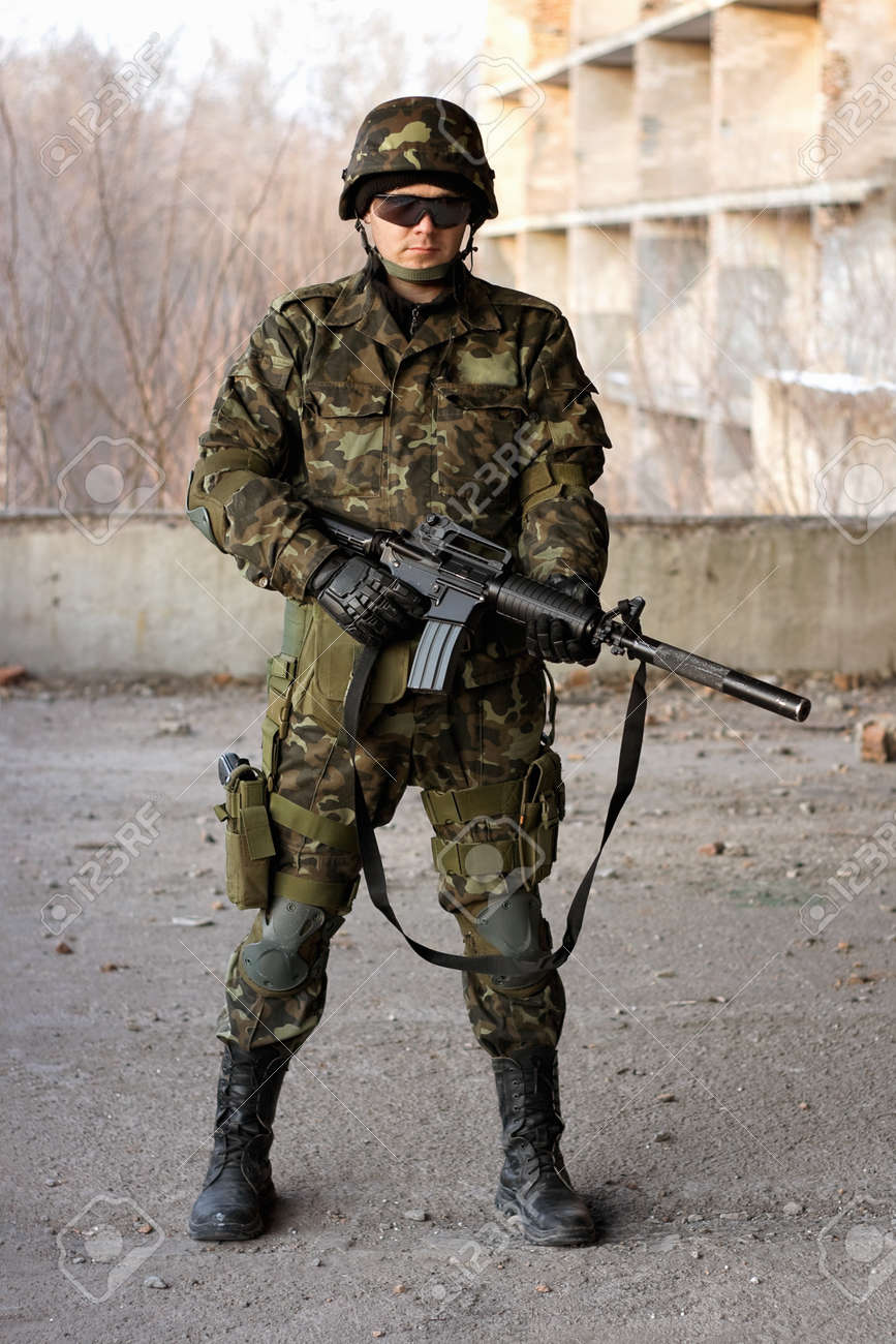 Young military man with a big rifle Stock Photo - 12983970