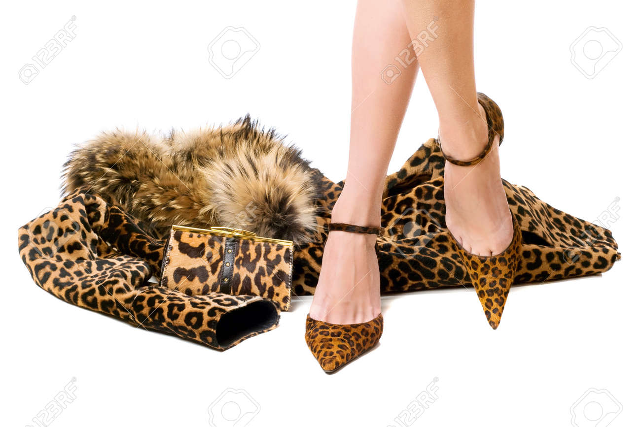 Pretty young feet in the spotted shoes Stock Photo - 13094283