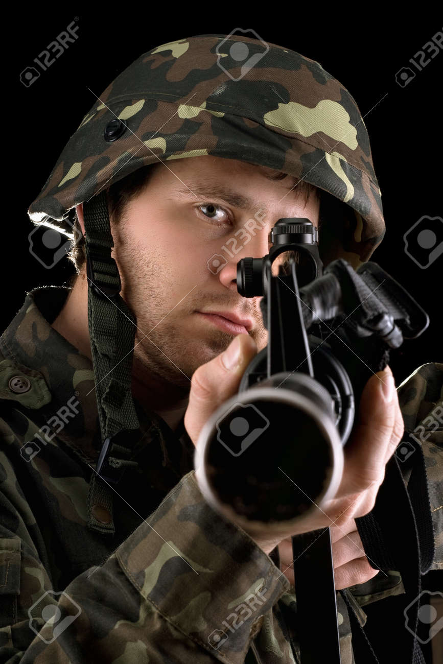 Ready Soldier Aiming A Rifle In Studio Closeup