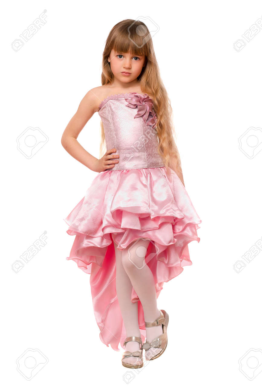 64a01dbbca33 Pretty little girl in a chic pink dress. Isolated Stock Photo - 13758716