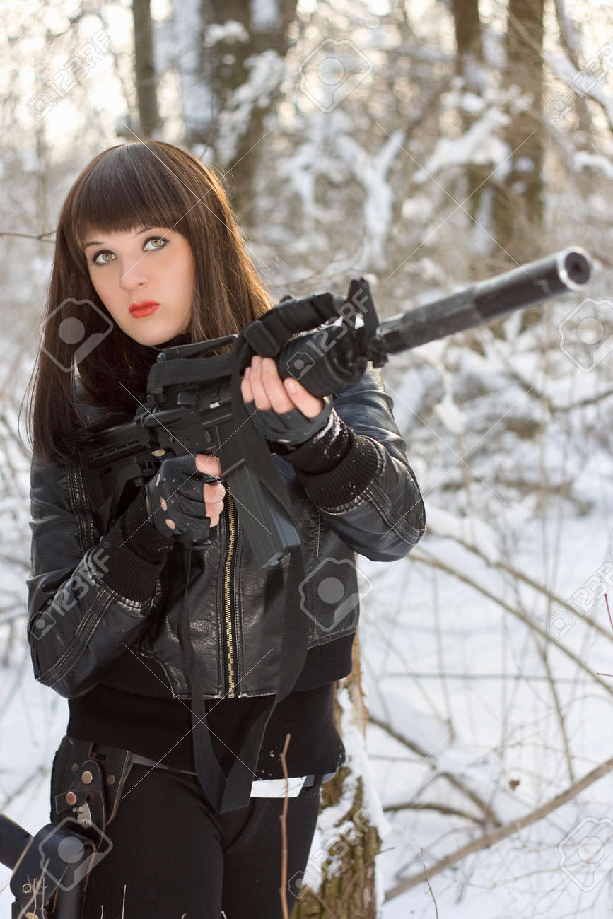 Portrait of young lady with a rifle Stock Photo - 15259956