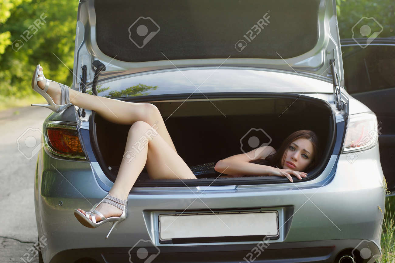 Sexy young woman in the trunk of car Stock Photo - 15544632