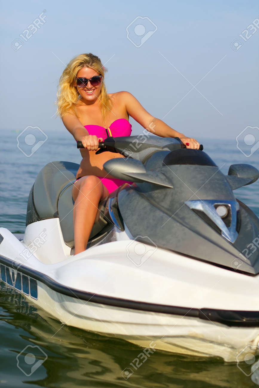 Beautiful smiling young woman on a jet ski Stock Photo - 15754699