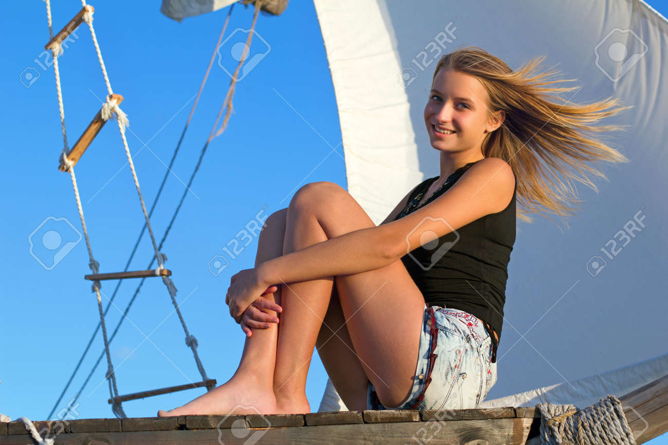 Beautiful teen girl sitting at stern of the ship Stock Photo - 16733201