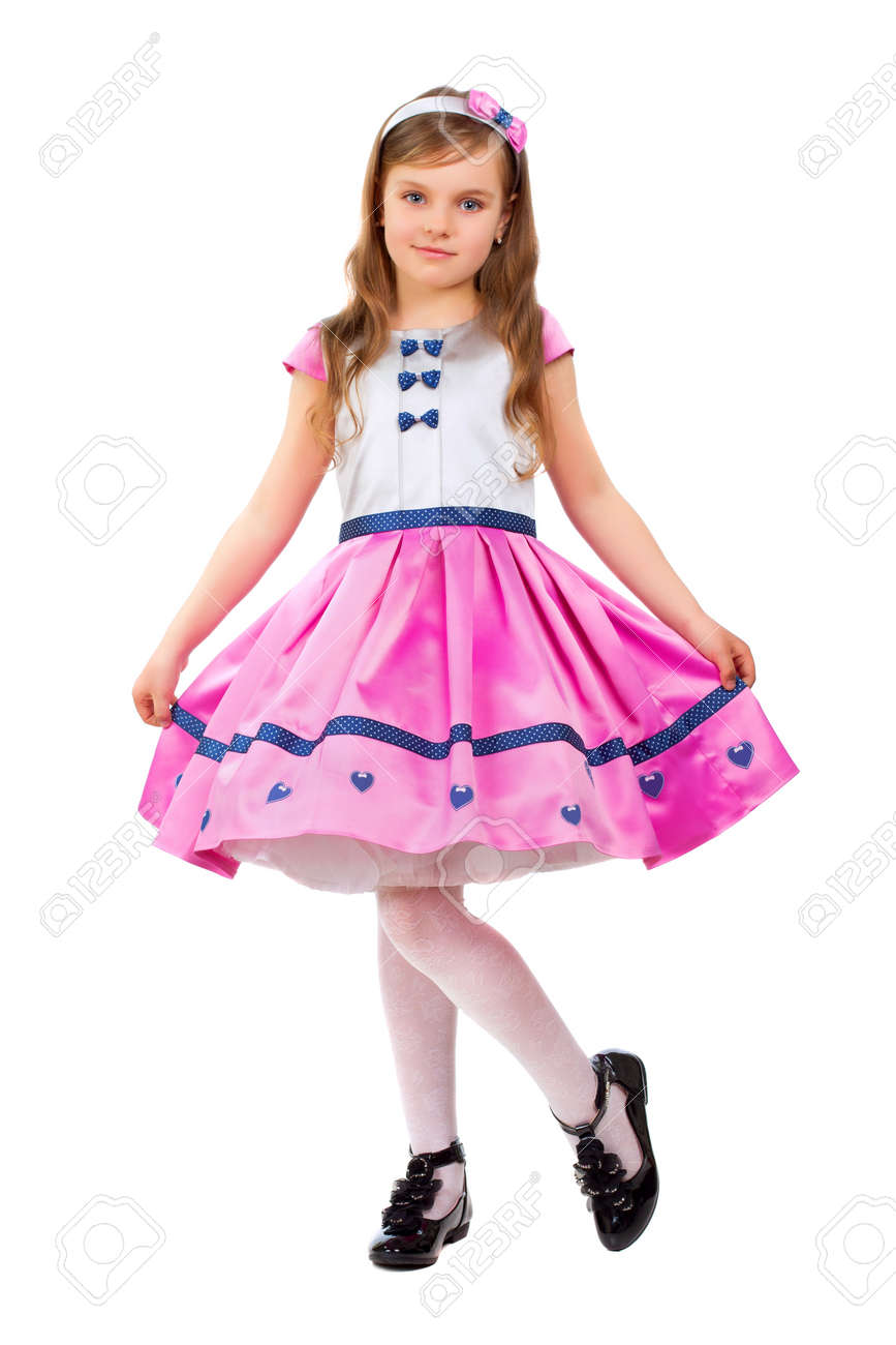 560ee2daa1f7 Nice little girl wearing white and pink dress. Isolated Stock Photo -  18936194