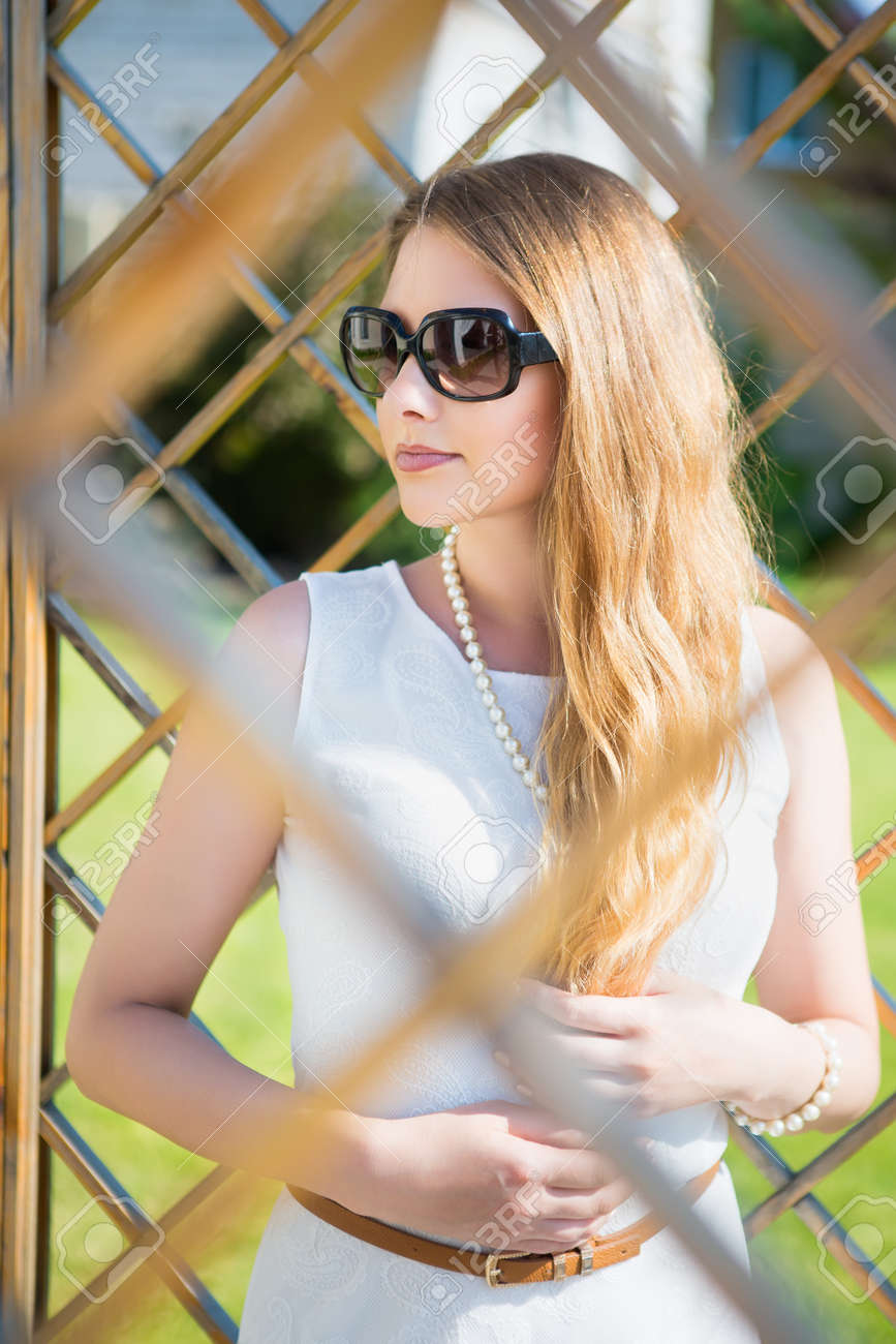 79abcb1c3f Portrait of beautiful thoughtful blond woman in sunglasses posing outdoors  Stock Photo - 61244555