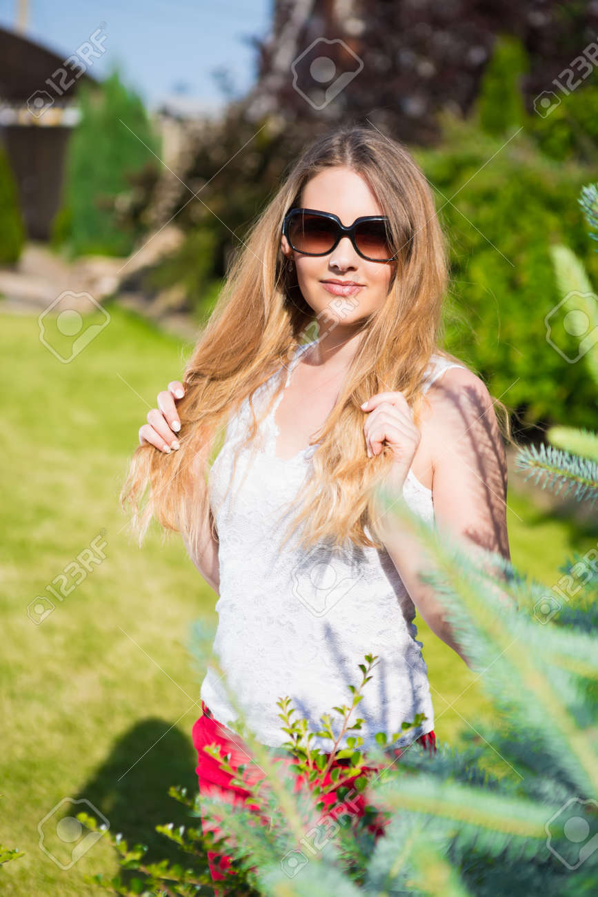491e149a2d Portrait of young beautiful blond woman in sunglasses posing outdoors Stock  Photo - 61244577