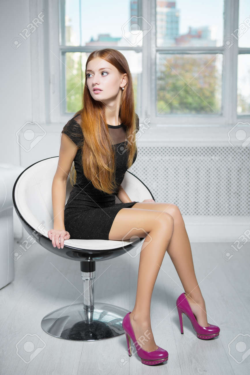 Thoughtful Red-haired Woman Wearing