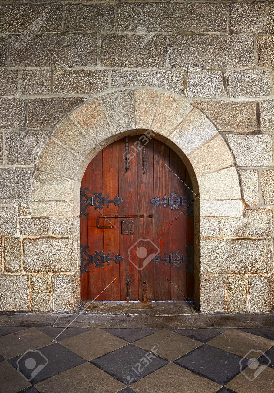 Ancient wooden door in old stone castle in Guimaraes Portugal Stock Photo - 26061447 & Ancient Wooden Door In Old Stone Castle In Guimaraes Portugal Stock ...